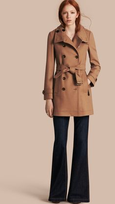 A military pea coat cut from a technical wool with a rich lambskin trim. A slight twist on the wardrobe perennial, the design is flanked by polished metal buttons with a contrast undercollar. Epaulettes at the shoulders and a martingale add heritage charm.