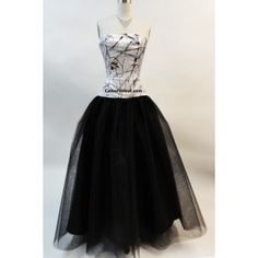 This full ball gown features a camo top with a dropped waist and layers of net for the full skirt. Shown in True Timber Snowfall and black net. Available in many net colors and all camo patterns in sizes 2-30.