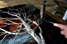 Stained Glass Tree Branches Sculpted Solder - This special window was for a home that wanted something truly unique. Using our sculpted soldering technique, we build the tree up to be three dimensional, creating bark texture, weaving branches in and out, doing our best to capture a bare winter tree.  WWW.waynecain.com