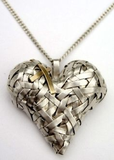 "Pendant | Patricia Gurgel-Segrillo.  ""Woven"".  Pure silver and 18k gold...not a heart person, but this is lovely."