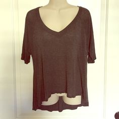 V neck lightweight top Cut top, comfortable lightweight thin material. Back of top is longer then front. Mid sleeve length. In good condition. The color is smoky gray. H.I.P. Tops Blouses