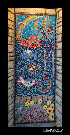 As I was walking in Redhook Brooklyn I noticed this work of art on this door! Please en-large for a better view.     I Love It !! Check out this awesome Mosaic sit