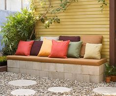 Easy DIY Garden Furniture- cement blocks topped with planks, cover with cushion and pillows