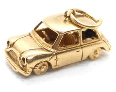 A Vintage gold 1965 Mini Car Charm with Moveable Wheels Vintage Charm Bracelet, Silver Charm Bracelet, Silver Charms, Wheels, Charmed, Antiques, Mini, Bracelets, Car
