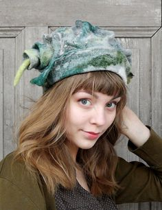 Beautiful fancy felted hat, hand-shaped, with tip, one of a kind, in shades of green and gray, wool with decorative silk fabric and wool curls. You can