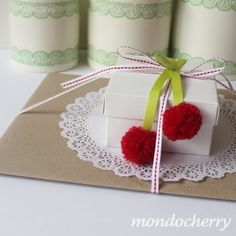 darling poms on the end of ribbon - very cherry