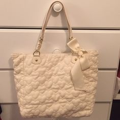 Betsy Johnson tote Super cute quilted Betsy Johnson tote bag. Used briefly but is way too large for my liking! Still in perfect condition! Betsey Johnson Bags Totes