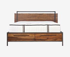 The Insigna bed mixes expert craftsmanship with rustic charm. Made from solid American poplar with a natural antique stain with metal legs and frame, and a metal railing along the headboard. There are