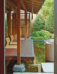 Kenzo Takada hired landscape architect Iwaki to create a Japanese-style garden for his home near Place de la Bastille.Here, a cantilevered deck next to a formal Japanese tearoom offers a quiet spot to view the koi pond.