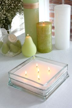 Glass Block Scented Candle-This glass block full of character on its own, filled with scented white wax. The top surface is combed to show a textured look. 5-wicks and comes in Gardenia (Clear Glass) & Ocean (Blue Glass) www.vancekitira.com