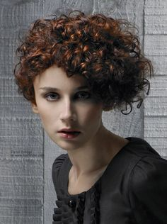 Naturally Curly Hair Cut In A Wedge Shape To Control The Bulkiness