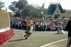 Characters dance in the Disneyland Parade done as a preview for television, on the first day of operation in July 1955