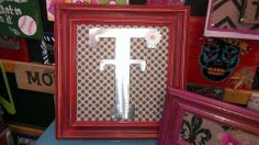 Metal 'T' on cabinet door, go to Diana's Plaque's on facebook for more wall decor