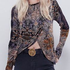 BNWT Free People Jersey Nouveau Swing Top Brand new with tags - Free People Jersey Nouveau Swing Top Printed mock neck top featuring a high low hem with a surplice front. Wide, oversized body with an open keyhole in back. Sheer lace along the shoulders with eyelash trim. Color: Coal Combo Size: Small Retail Price $88 Free People Tops Blouses