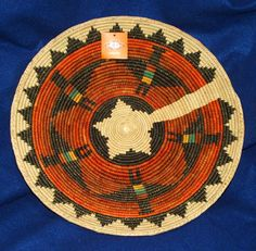 """A beautiful finely woven thunderbird basket that measures 14.5"""" in diameter & is 2.5"""" in depth. So pretty & colorful, it can be used as a decorative accent & hung on a wall. $24.95 + shipping #basket #handwoven #homedecor #thunderbird #southwestern"""
