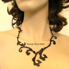 Necklace. Rubber and Sterling Silver. More creations on page: http://www.facebook.com/ArjasUni