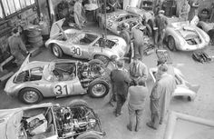 Porsche porn: the entire Porsche lineup and spare cars, '58 Le Mans. Ferry Porsche in the middle with the hat on. (George Phillips photo)