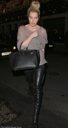 Helen Flanagan vamps it up in her favourite leather thigh-high boots for dinner with a pal but seems to have her night ruined by 'snobby people'   Mail Online