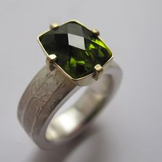 Green tourmaline gemstone ring with etched silver and gold