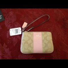 """Coach Signature Strip Wristlet Coach Signature Stripe corner zip wristlet.  Interior is fabric lined with 2 id/card slots.  6.25"""" x 4""""   Comes with Coach care card, Coach gift box and gift bag. no trades Coach Bags Clutches & Wristlets"""