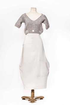 Hand knitted sweater and stretch jersey skirt. Can be worn separately or buttoned together for a complete outfit.