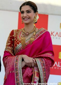 At the inauguration of #KalyanJewellers store in #Chennai, checkout #SonamKapoor's drop dead gorgeous  #pinkbanarasisilk #embroideredsaree by Abu Jani Sandeep Khosla! Embellishing it with traditional gold jewellery and a braided up-do to complete her look, isn't she looking #gorgeous!!