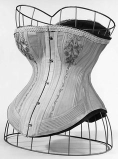 Corset Date: 1885–87 Culture: American Medium: cotton, silk, metal, bone, elastic Dimensions: Length at CB: 13 1/2 in. (34.3 cm) Credit Line: Brooklyn Museum Costume Collection at The Metropolitan Museum of Art, Gift of the Brooklyn Museum, 2009; Gift of E. A. Meister, 1950 Accession Number: 2009.300.3497a–c
