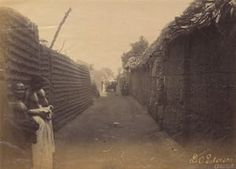 View along a street in the royal quarter of Benin City, from 1897.