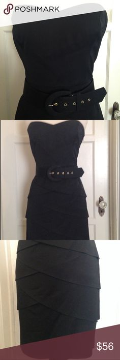 Trina Turk Classic Black Party Dress. Size 8 Pre owned but worn only for a promo shoot for THe Real Housewives of BH, this classic Trina Turk dress is fully lined with a lace slip of polyester. The dress itself is constructed of a rayon/viscose mix. Sweetheart neckline, tiered pencil skirt, side zip, and wide belt set it off. Size 8. Absolutely beautiful and well constructed as you would expect from Trina Turk. Trina Turk Dresses Strapless