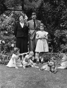 Queen Elizabeth, King George VI, Princesses Margaret and Elizabeth, and dogs. King George VI Queen Elizabeth I and their daughters.