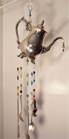 One of a kind, repurposed, beaded silverware wind chime -Razzle Dazzle by PassingTimeandChime - ON SALE Was $65.00 Now $60.00 Give them the old razzle, dazzle....razzle dazzle them..... with this beautiful wind chime that has been repurposed from a lovely old Oneida footed tea pot. Hanging from and forming the musical instruments you will find a very ornate salad fork, a butter knife, a teaspoon, a large slotted serving spoon and this cute little silver salt shaker. Now that we have the…