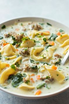 Creamy sausage and tortellini soup is a bowl full of comfort! It's loaded with veggies, sausage and cheese tortellini- plus it comes together in just 45 minutes!