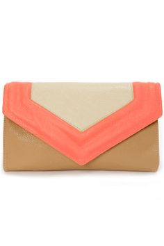 Check it out from Lulus.com! If your loyalties lie with awesome accessories, then the On My Side Brown and Neon Coral Purse is your perfect companion! Brown vegan leather gets a pop of color from a front flap with neon coral and grey vegan leather, while gold hardware and a zip pocket at back add chic detail. Lift magnetic flap closure to reveal two main interior compartments with black print lining plus an additional interior zip pocket with a logo tag. Carry as an over-sized clutch, or…
