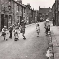 Anyone remember the days of street football and kerbs, when roads weren't full of speeding idiots...
