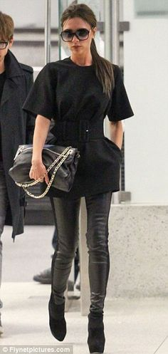 Victoria Beckham looks fantastic wearing a pair of black leather-style trousers, a long line black top belted at the waist, paired with black suede boots and sunglasses - from her own range, Victoria Beckham Eyewear ♥