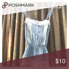 Pinstripe top Cute pinstripe top with lace and button detailing. Cross back straps. Hollister Tops Camisoles