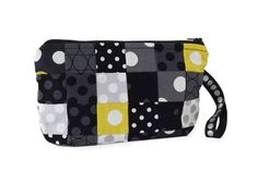 Piece a variety of polka dot fabrics into a patchwork pouch. These fabrics  are from the Dots collection from Michael Miller Fabrics [1].   [1] http://www.michaelmillerfabrics.com