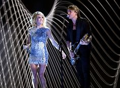 Carrie Underwood Photos Photos - Recording artists Keith Urban (R) and Carrie Underwood perform onstage during The 59th GRAMMY Awards at STAPLES Center on February 12, 2017 in Los Angeles, California. - The 59th GRAMMY Awards - Show