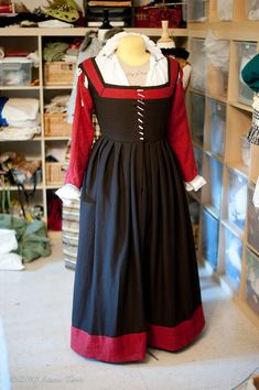 Another kirtle, but front-lacing + multicolored, with slashes for the smock sleeves to puff through.  More a German look than English.