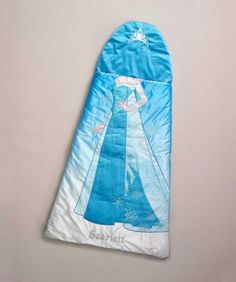 girls personalized frozen sleeping bag - exclusively ours -Does your girl dream of being Elsa? She'll slip easily into character in this beautiful sleeping bag. A crown graces the attached pillow, while sparkles and snowflakes decorate the Queen of Arendelle's dress. Her name's (maximum 12 characters) embroidered at the foot of the luxurious bag, above a secret zippered pocket big enough for pj's and favorite gloves. Plush lining, soft padding, sturdy zippers, opens fully.