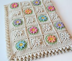 Gorgeous flowers granny square pattern and such a romantic design! The flowers are really pretty and the pattern is great for pillows, baby blankets and throws.