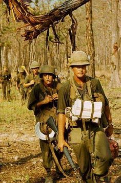 Members of the US 1st Air Cavalry, march through the forest en route to Chu Phong mountain, in the Ia Drang Valley, Vietnam, 1965.