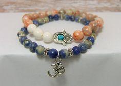 "Sodalite & Red Vein Jasper,  White Magnesite Gemstone BRACELETS ~ Hamsa + Om Charms, Daisy spacers ~ 6-8 mm beads ~ stretch, approx 7.5"" www.sgtpepperscreations.etsy.com #gemstonebracelet #stacking bracelets #Omjewelry #hamsa #sodalite #redveinjasper"