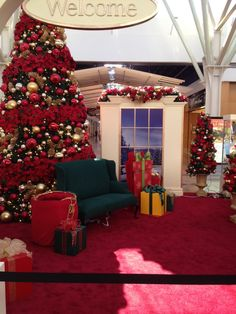 A perfect spot for guests to take a picture with #Santa. #holidaydecor #commercialdecor #northwestarkansasmall