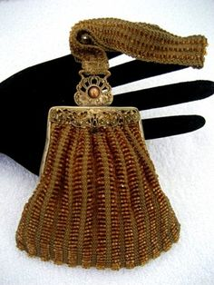 I love the uniqueness of this little dance bag. What a wonderful lost era of grace and beauty.