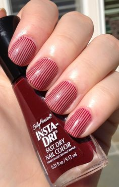 candy stripes in dark red over pink manicure