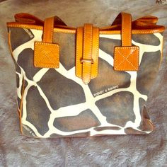 Dooney & Bourke bag This bag has my favorite animal print...the giraffe! It's in great condition with minor wear on the bottom. Please ask questions or for more pics  Dooney & Bourke Bags Shoulder Bags
