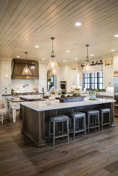 stained floor, stained island & shiplap ceiling