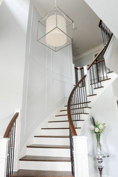 pretty staircase that isn't covered in frames or completely bare.