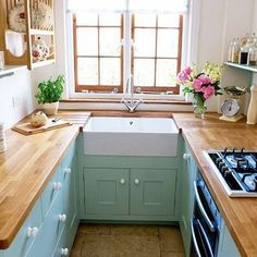 gorgeous small kitchen with butcher block counters: